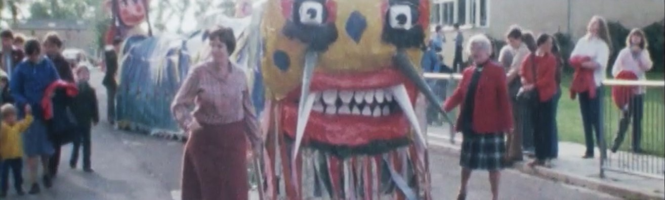 Screenshot from BFI video of Burford Dragon Ceremony, 1980