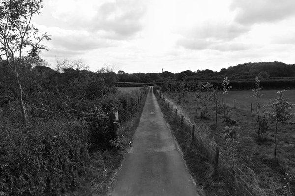 Road leading to Hilltop Garden Centre, near Ramsden
